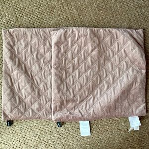 Pair of blush colored pillow shams